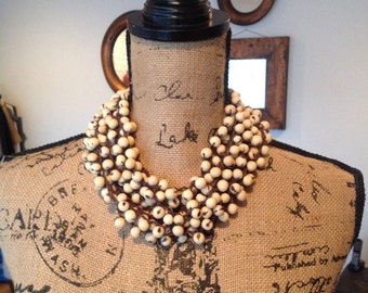 Handmade multistrand necklace of acai seeds