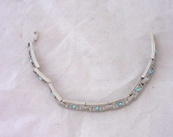 Vintage bracelet with rectangular links inlaid with blue stones (glass)