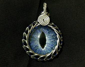Ice Blue Hand-Painted Dragon Eye Pendant w/Silver and Navy Blue Wire Wrap (with Necklace)