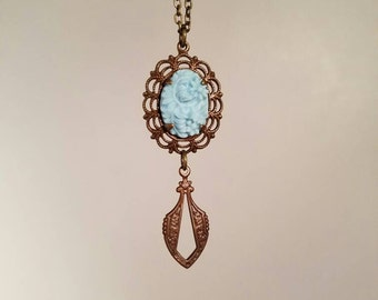 Blue floral vintage style brass dangle necklace