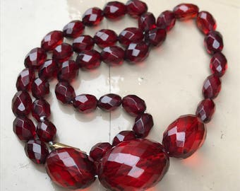 1930's cherry amber bakelite faceted bead necklace with barrel closure