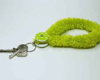 Keychain fluffy green with a large green button with white dots, pendant Keyring - pendant keychain