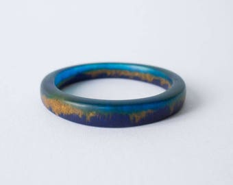 SALE 25% OFF Bracelet Bangle MEDIUM Resin Art, Thin shaped 'Elouera' aquamarine, deep blue and gold pigments, bangle by Clan Collective