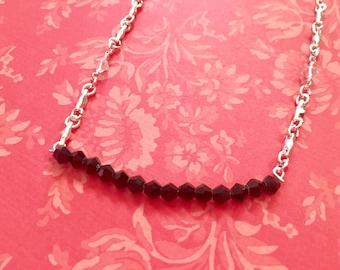 black crystal beam necklace.