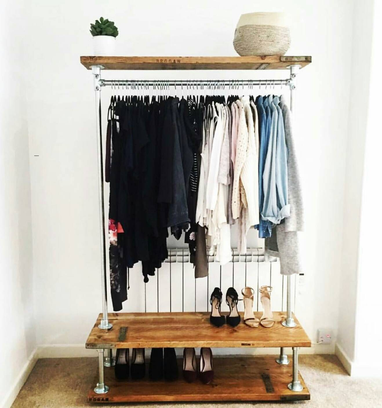 Vintage industrial clothes rail with storage shelves.