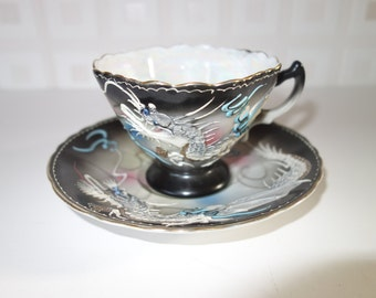 Japanese embossed dragons cup and saucer set