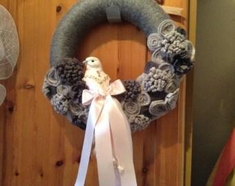 Yarn bound Xmas wreath with bird