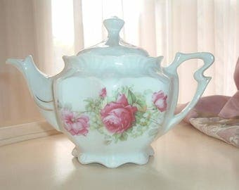 teapot with roses and lily of the valley