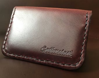 Enthusiast dark red four pocket card wallet.
