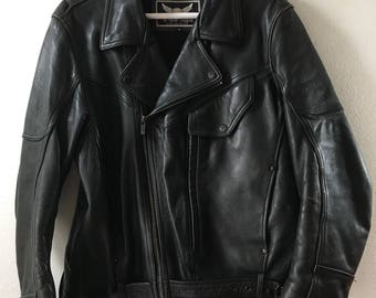 Black leather motorcycle jacket , men size medium .