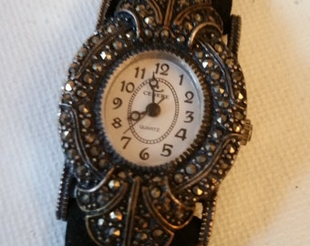 Marcasite watch with black band, needs battery