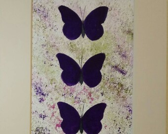 Trio of purple butterflies.