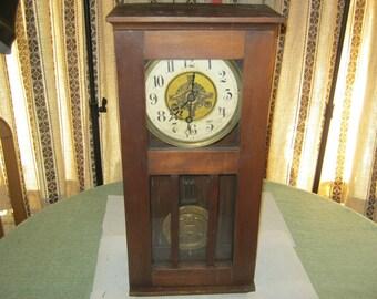 Pendulum clock with shock, wall clock, wood cabinet ca. 1920 Germany, height ca. 62 cm, ready-to-ca. 25 cm, depth ca. 15 cm