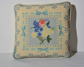 Flowers and bows vintage needlepoint pillow.