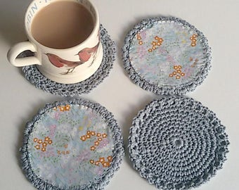 Grey Crocheted coasters with cotton lining