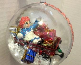 Raggedy Ann in a wagon Ornament