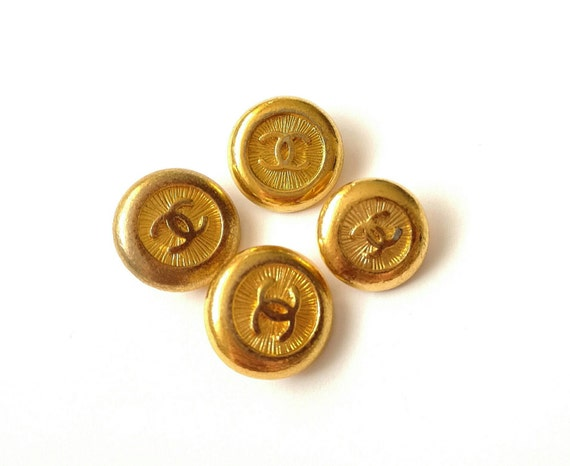 Lot of 4x Authentic Chanel vintage gold plated metal buttons in used condition in different sizes