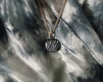 Fused dichroic glass zebra striped black and silver pendant and shades of grey hand dyed silk scarf