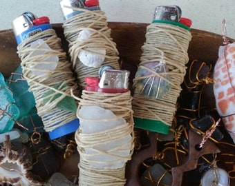 Hemp Wick lighters that come with a surprised wrapped Hawaiian gift.