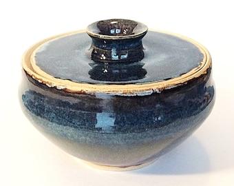 Medium Sized Multi Colored Lidded Jar