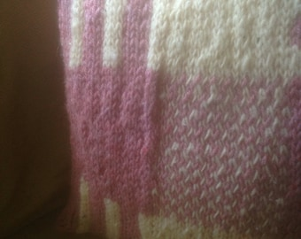 Hand knitted patterned cushion