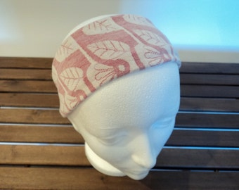 Headband. White, rose and red colors. With patterns.