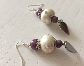Purple earrings and beige