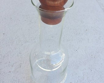 Pair of mid-century Danish glass decanters with teak stopper by Dansk