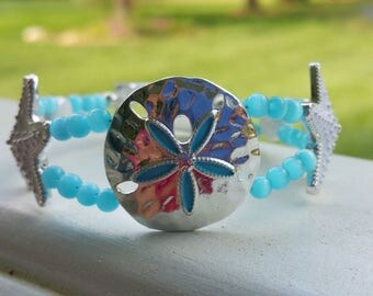 Aqua, silver and white sand dollar and starfish beaded bracelet with silver fold over magnetic clasp