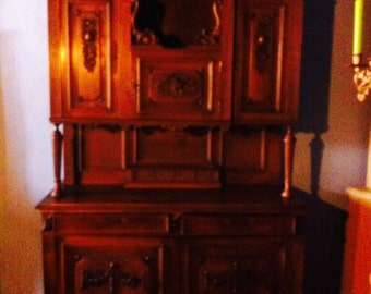 A French 19th mahogany buffet, very nicely carved with garlands and finials.