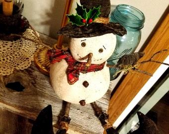 Primitive Snowman with a Crow