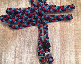 Red, turquoise, and black reins