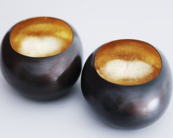 Two Metal Candleholders With Gold Inlay