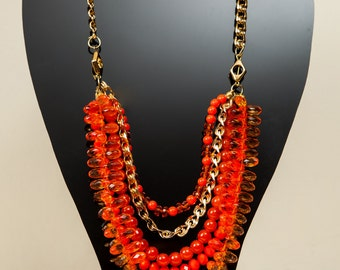 Beaded orange and gold necklace.