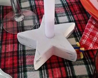 Wooden star shaped candle holder.