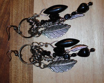 Earrings with feathers and black balls
