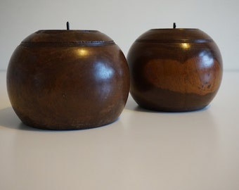 A pair of candle holders in lignum vitae