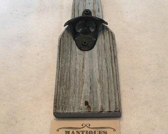 Bottle opener on distressed lumber