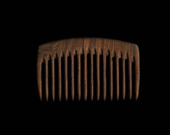 A wooden comb made from Lapacho wood.