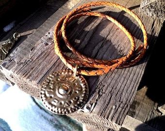 Amulet Viking bracteates. Handmade bronze.