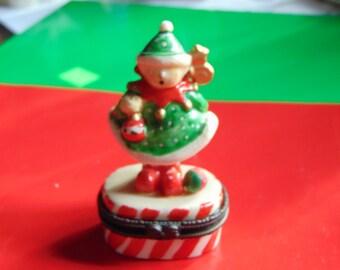 Santa's Helper  trinket box on a candy cane striped box  with an Christmas orniment trinket