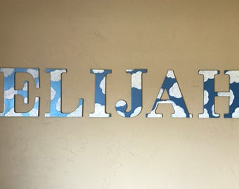 Custom, hand painted sky and clouds wood name sign; sky nursery letters