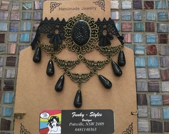Black chocker with dangalng pendents