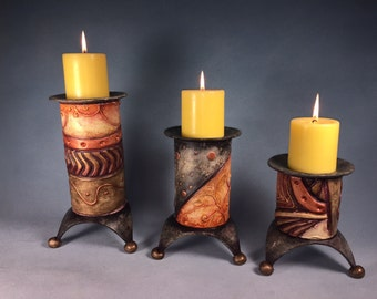 Set of three ceramic candle holders