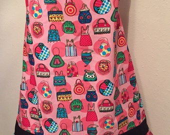 Pink Background Apron, Multi colored Purses, with hand sewn Beading Adult size
