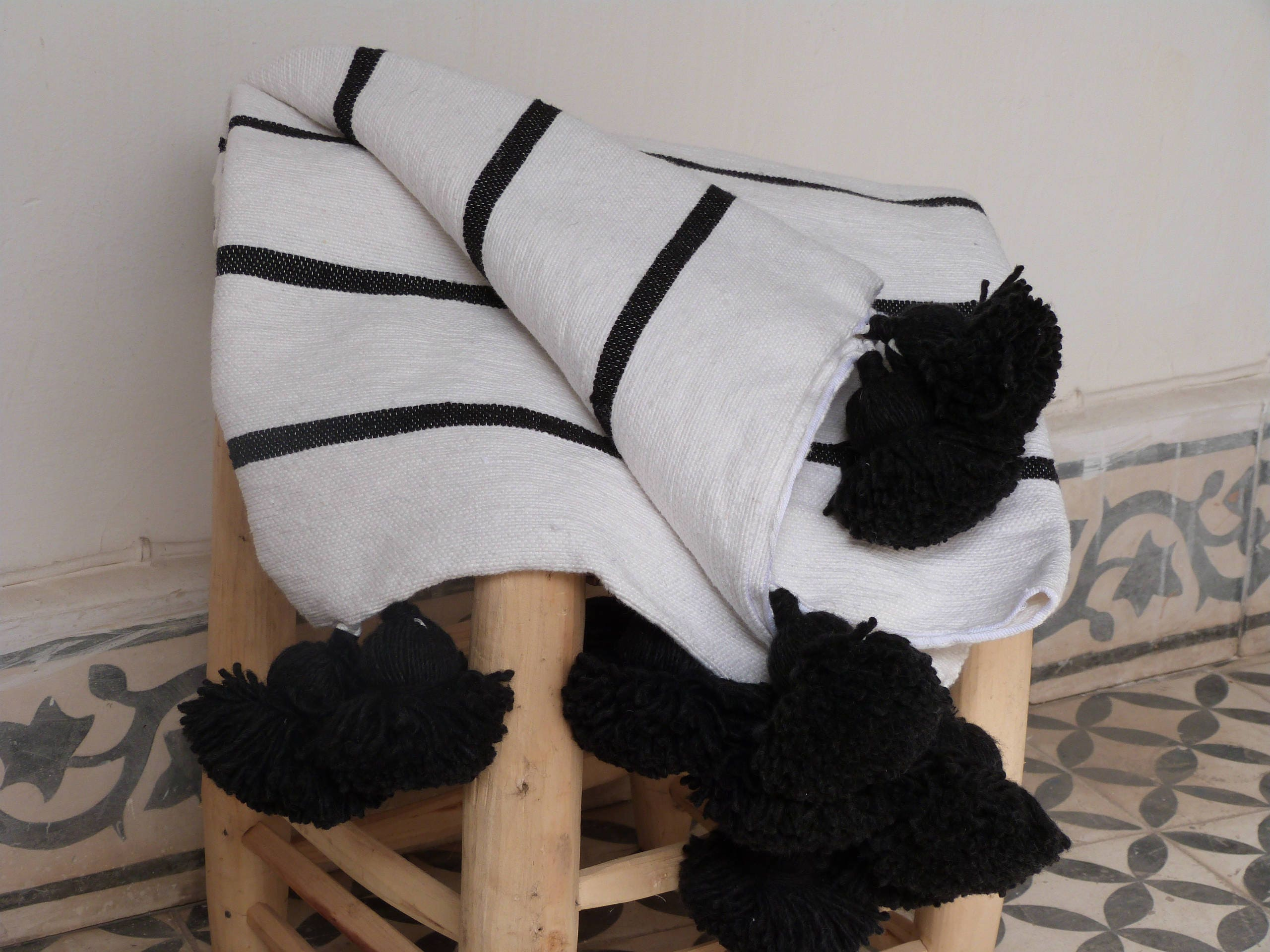 moroccan stripes pom pom blankets black and white throw. Black Bedroom Furniture Sets. Home Design Ideas
