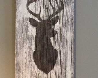 deer head silhouette on barnboard