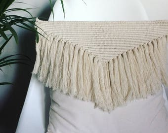 In macrame decorative cushion