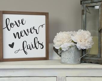 "Rustic Wood Sign - ""Love Never Fails"" - 13"" x 13"""