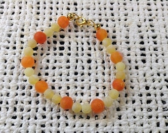 Orange and yellow frosted bead bracelet